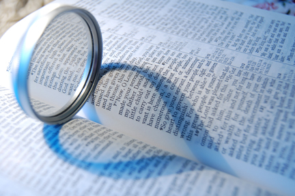 Ring on Bible with Heart-Shaped Shadow